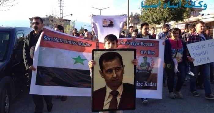 متظاهرون في لواء الاسكندرون يؤيدون الاسد ويعتدون على جرحى سلفيين عائدين من معركة كسب